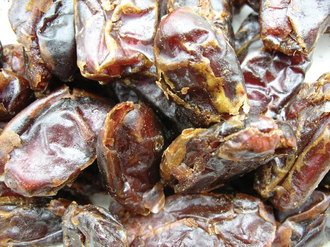 Golden Sunrise Foods.  Pitted dates.  Ingredients:  dates, vegetable oil.  Produce of Iran.  May contain nut or stone traces.