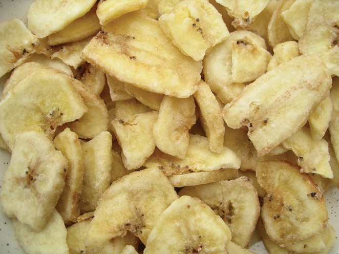 Golden Sunrise Foods.  Banana chips.  Ingredients:  green banana, coconut oil, sugar, banana flavour, honey.  May contain nut traces.  Produce of Phillipines.