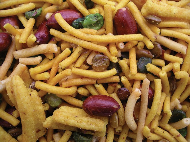 Golden Sunrise Foods.  Bombay mix.  Ingredients:  gram flour, peanuts, green lentils, chick peas, green chick peas, vegetable oil, salt, spices, colours, ajwain seeds, colours E110, E102.  May contain other nut traces.