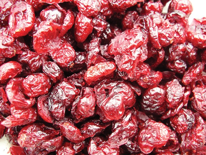 Golden Sunrise Foods.  Sweetened dried cranberries.  Ingredients:  cranberries, sugar, sunflower oil.  Produce of Canada.  May contain nut traces.